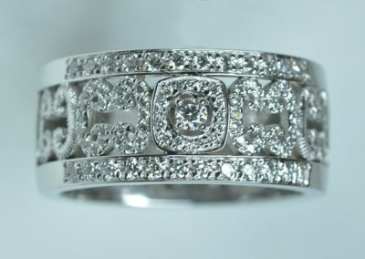 Bague motifs diamants or blanc