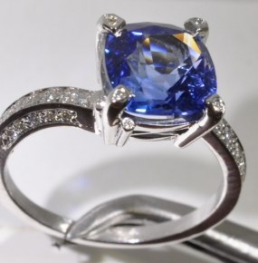 Sapphire white gold cushion and diamond ring