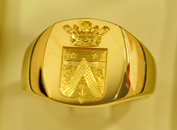 Armored signet ring