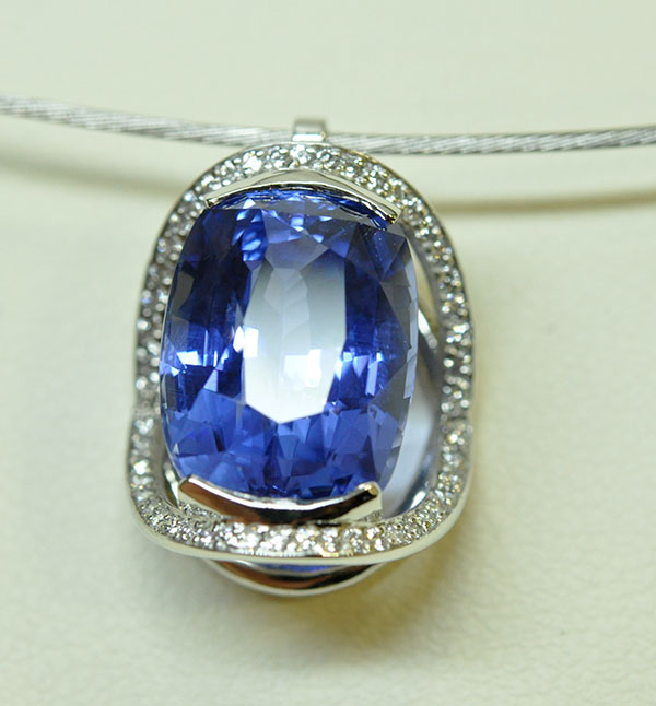 Diamond sapphire pendant mounted on a white gold necklace