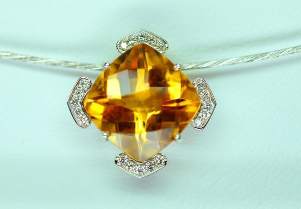 Briolette size citrine pendant, yellow gold diamonds mounted on a white gold cable