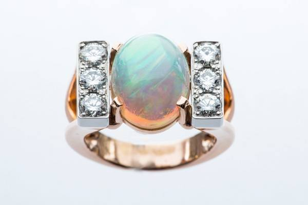 platinum opal ring mounted on platinum and rose gold