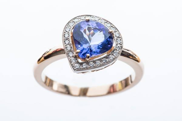Pear tanzanite ring, white gold rose gold diamonds
