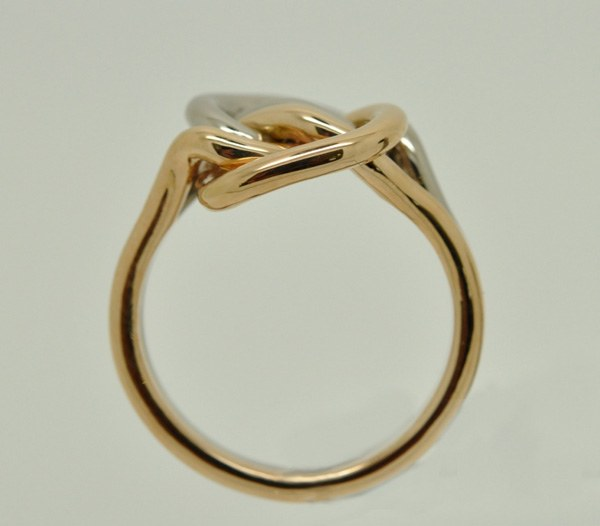 Love ring in the shape of a knot. Rose gold & white gold – 1/2