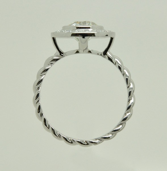 White gold diamond ring, twisted 1/2 ring
