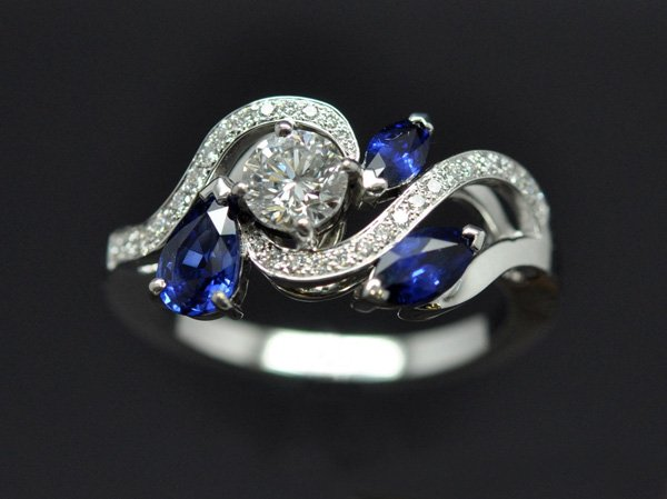 Diamond sapphire ring mounted on white gold.