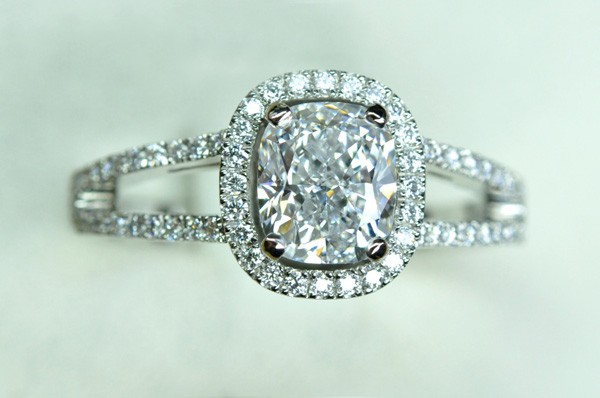 Diamond cushion, entourage diamonds. Platinum frame