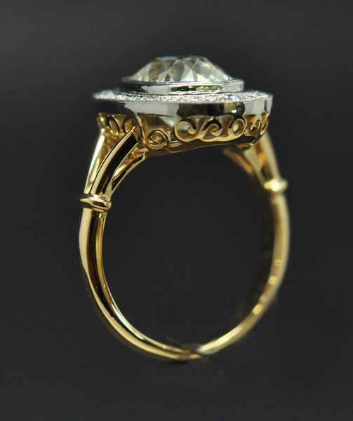 Old size cushion diamond ring