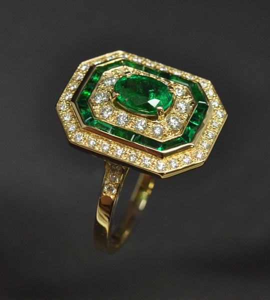 Emerald diamond ring mounted on yellow gold