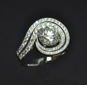 Bague double tourbillon diamants or blanc
