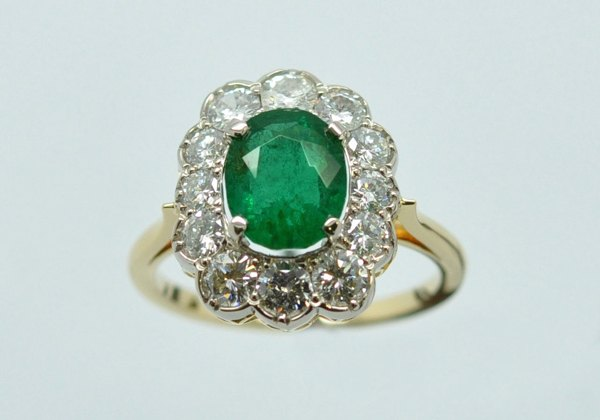 Emerald white gold and yellow gold diamond ring. Basket cut.