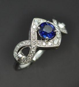 Bague Infinity or blanc diamants saphir