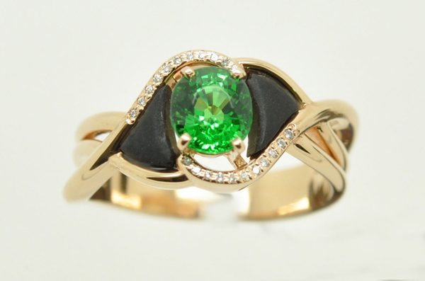 Rose gold ring. Tsavorite garnet in the center, diamonds and ebony