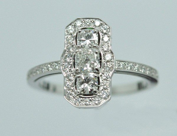 Elongated ring with three diamond cushion shapes