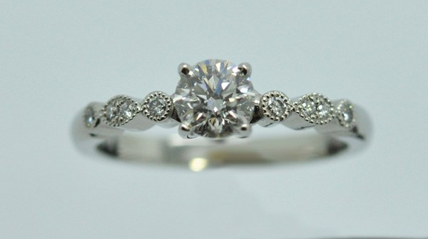 Platinum engagement ring accompanied with 6 small diamonds
