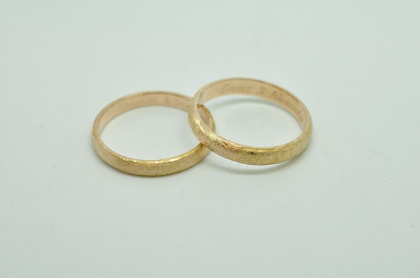 Hammered and brushed yellow gold wedding rings