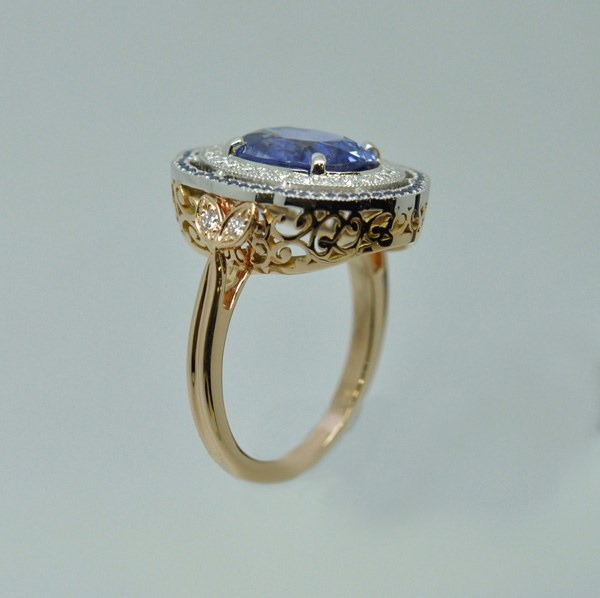 Ceylon sapphire with surrounding small diamonds