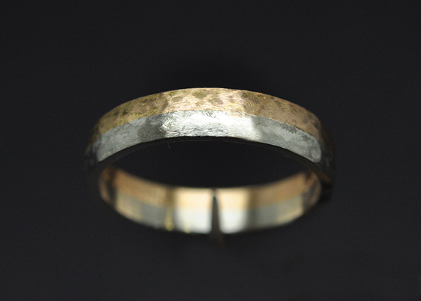 Platinum rose gold wedding band. Raw, slightly hammered with a passage of emery paper.