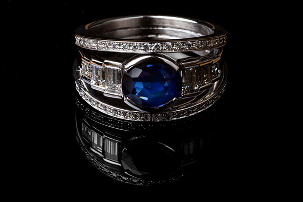 Sapphire diamond ring. In the center a frame with a drop of baguette diamonds. On both sides, two lines of diamonds
