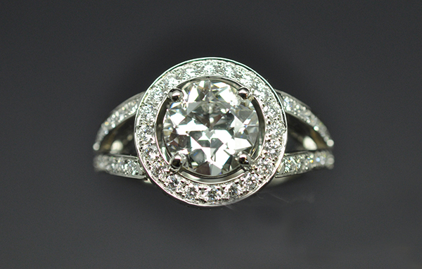 Round ring, palladium white gold setting. Half-cut center diamond (old cut).