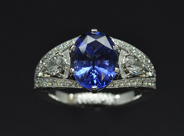 Sapphire diamond ring. Pear diamonds with secret engraving above